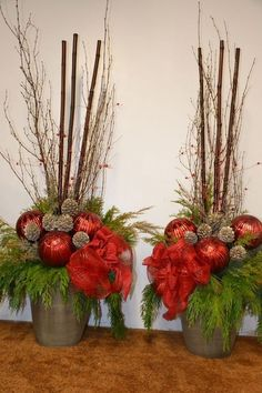 ▷ 1001 + ideas for Christmas arrangements for crafting - two flower pots with big red christmas balls and small branches, big sticks christmas arrangements - Christmas Urns, Christmas Planters, Christmas Flowers, Outdoor Christmas Decorations, Christmas Centerpieces, Christmas Balls, Rustic Christmas, Christmas Holidays, Christmas Wreaths