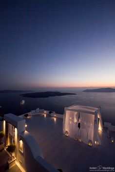 How to propose using a canopy.  Santorini wedding terrace - view of the caldera bay
