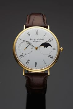 IWC MOON PHASES YELLOW GOLD International Watch Co., Schaffhausen, No. 2463432, case No. 2481715. Made in the 1980s. Fine and rare, large, astronomic, 18K yellow gold wristwatch with moon phases.