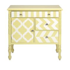 This quaint chest of drawers will give your room a foundation of warmth and whimsy. The soft yellow color and bold white graphic patterns work together to bring your room to life.