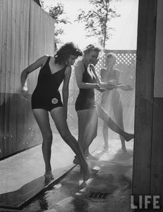 bygoneamericana:  Women showering sand off themselves at a Servicemen's Country Club. Chicago, 1943. ByCharles E. Steinheimer