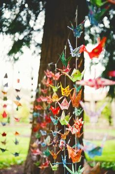 Wedding by Stephanie Haller Photography Origami cranes strung on fishing line make a beautifully colorful backdrop at an outdoor reception.Origami cranes strung on fishing line make a beautifully colorful backdrop at an outdoor reception. Origami Wedding, Diy Wedding, Wedding Simple, Wedding Ideas, Party Wedding, Wedding Reception, Party Girlande, 2017 Wedding Trends, Wedding 2017