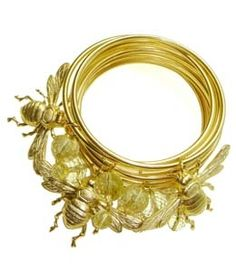 "Gold Bee Bracelets- This set of 10K gold plated bangles with bee charms and gold spun rutilated quartz is sure to call attention to any look day or night. 3 Doves eclectic but stylish jewelry is distinct and will have people asking; ""Oh my gosh where did you get that piece of jewelry?"""