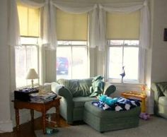 Another option for bay window treatments would be to use shades that gather up at the top of the window.