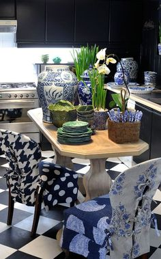 TG interiors - love this little table & those slip covered chairs just make this design so special!