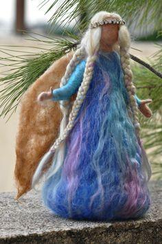Needle Felted Waldorf  Christmas Tree Topper-Winter Frosty Fairy. Needle felt by Daria Lvovsky. $98.00, via Etsy.
