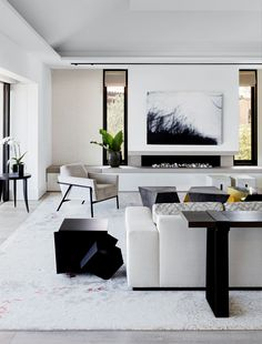 "[Thomas Hamel & Associates](""_blank"") and [Behurz Studio](""_blank"") collaborated on the living room's area rug. Artwork by Chris Langlois from [Olsen Irwin](""_blank""). Living Room Area Rugs, My Living Room, Living Room Decor, Living Spaces, Living Room Artwork, Bohemian Interior Design, Modern Interior Design, Living Room Inspiration, Interior Inspiration"