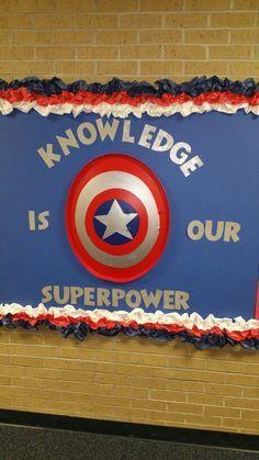 Patriotic Bulletin Board - Visit to grab an amazing super hero shirt now on sale! Superhero Bulletin Boards, Superhero Classroom Theme, Library Bulletin Boards, Classroom Themes, Superhero Party, School Displays, Library Displays, Book Displays, Library Themes