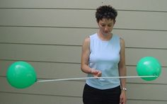 Dance involving balance using balloons - for younger children, balance between foreheads to experience body shapes; older students balancing balloons on stick while moving through space - which types of movements are possible with more/less energy