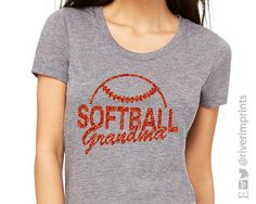 Show your SOFTBALL GRANDMA pride in this glittery tee shirt, with your choice of glitter color! This LAT Fine Jersey T-Shirt has a relaxed fit that's perfect for cheering on your little baseball playe