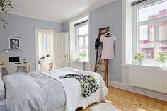 cool blue bedroom with hardwood flooring