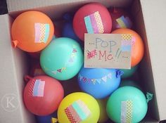 """A cake in a jar and a bunch of """"pop-me"""" balloons make for awesome box-fillers to wish a happy birthday from afar."""