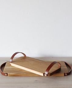 The Fitler Trays are made from white oak and have adjustable leather handles that make carrying chopped food easy. Fold straps down for storing or presenting on a table. Available in both large and sm