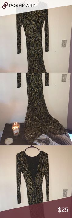 Never worn prom dress This is a prom dress that I never got to wear. It is black with gold pattern. The entire thing is super sparkly! It's plain, long sleeved, with a low-cut back. The dress is long and tight with a bit of flare at the bottom. This would be stunning at any prom!  Dresses Prom