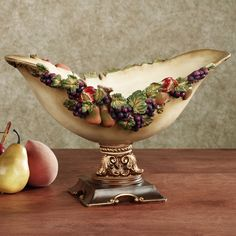 """The """"Falls Bounty Centerpiece Bowl"""" from Touch of Class. I love Tuscan-style decor with dellarobia designs like this. I think it's elegant and rustic all at once. $85.75"""