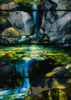 "Detail of the waterfall in the ""Autumn Landscape"" stained glass window by Louis Comfort Tiffany. Made 1923."