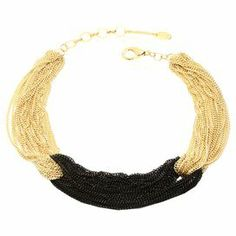 """Gathered gold-hued and black chain links make this chic necklace a bold addition to your favorite ensembles.   Product: NecklaceConstruction Material: BrassColor: Black and goldFeatures:  Multi-chainColor-block designDimensions: 12-14"""" Diameter"""
