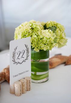 table number is propped up by corks at this winery wedding