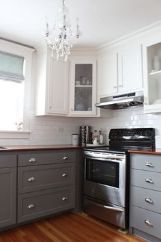 This 2 tone look is really growing on me! Dark bottom cabinets, white top cabinets. Half the painting! :) love the counter top but we would do something different