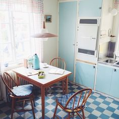this reminds me a bit of my Nana's kitchen with the built in cupboards. She had a central table and chairs and sliding glass fronted cupboards above head height.