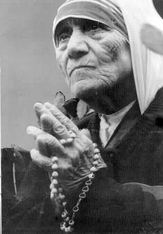 "Mother Teresa bringing light to the world. ""If we have no peace, it is because we have forgotten that we belong to each other"""