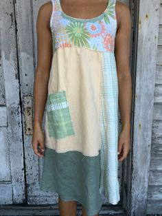 Romantic/Tattered/Rustic/Boho/Gypsy Dress upper part of dress is made with cotton and has added knit trim along neckline lower part is made with panels and has added pocket along front and tie along back Size-medium large chest-40 has stretch hips-46 length-38