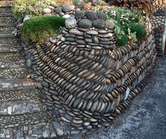 Not only are the retaining walls constructed of river rock, the steps and the siding of the house are embedded with river rock. | ©Rozanne, via flickr