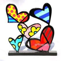 Romero Britto Heart Figurine  http://www.squidoo.com/inexpensive-hand-painted-gifts-for-valentines-day