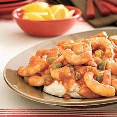 Creole Shrimp and Grits. (Recipe from Southern Living - Photo: Beth Dreiling Hontzas; Styling: Lisa Powell Bailey - http://www.myrecipes.com/recipe/creole-shrimp-grits-10000001867539/#)