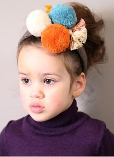 Tia Cibani Kids Pompom Tassel Headband Verde colorway is the one with Yellow and Purple Pom / Green band