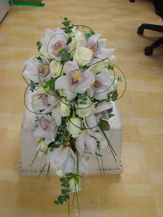 orchids and roses in a modern shower bouquet with grass loops www.weddingflowersbylaura.com