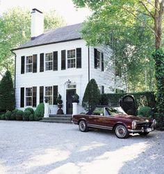 pea gravel driveway + black shutters