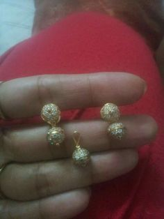Gold and white stone pendant and  earrings