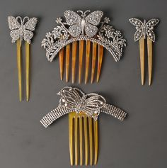 A late 19th/early 20th Century cut steel and faux tortoiseshell ornamental hair comb, the hinged
