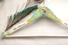Peacock Wedding Hanger, Bridesmaids Gift, Pesonalized Wedding Hanger, Bridal hanger, Mother's day Gift, Boho Wedding, Shower party, Wedding by InspirellaDesign on Etsy https://www.etsy.com/listing/387164516/peacock-wedding-hanger-bridesmaids-gift
