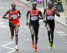 Is Kiprotich a famous family name? Gold-medalist Stephen Kiprotich of Uganda, left, competes with Kenya's bronze-medalist Wilson Kipsang Kiprotich, center, and silver-medalist Abel Kirui in the men's marathon at the 2012 Summer Olympics, Sunday, Aug. 12, 2012, in London. (AP Photo/Mike Groll)