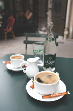 Two coffees at a cafe in Paris. It's missing an ashtray and some fresh cigarettes, but we'll manage. :)