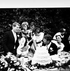 Jackie getting used to the close-knit camaraderie of her new family before they cut the wedding cake.