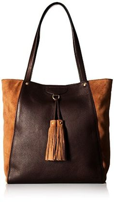 24c944ae65bd Slouchy hobo bag featuring tassel accents at front and hardware feet.