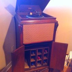 Dad turned an old record player into a wine cabinet for Mom's Christmas present.