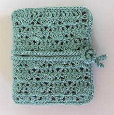 Crochet hook organizer....I want to learn how to make one of these.
