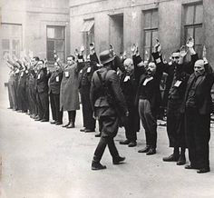 "Warsaw Ghetto Uprising: Photograph of SS troops arrest the Jewish department heads of the Brauer armament factory. The Brauer firm was likely helmet repair ""shop"" of Herman Brouer at Nalewki 28-38 street employing 2 thousand people."