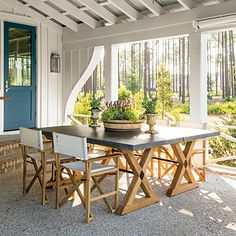 Porch: The Decorating | Mimicking the style of the living room, this outdoor porch is made stylish and comfortable with a blue-and-white palette, flexible seating arrangements and an edited mix of styles and materials.