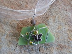 wire wrapped recycled glass pendant. Wire Wrapped Recycled Green Glass Necklace By UniqueChiqueJewelry, $15.00 Pendant C