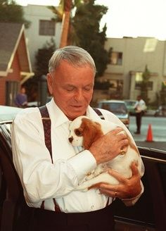 Frank Sinatra with one of his King Charles Cavalier spaniels, 1990.