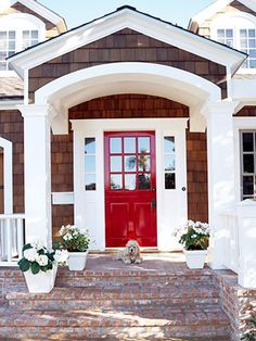 I adore everything about this - the timber shingles, the red door, the white columns and mouldings, the red brick steps.