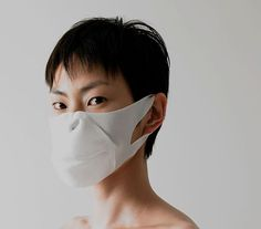 "Swine flu may yet make a monkey out of some cautious Japanese with this new nanofibre mask from Mint Designs. Made from Smash, an advanced polyester, and debuted at the Senseware exhibition in Milan, this simian slip-on offers a roomier fit than most traditional Japanese oxygen filters. The fact that wearers resemble the hero of the cult 80s supernatural martial arts serial ""Monkey"" might give the superstitious an extra talisman against the evils of airborne illness."