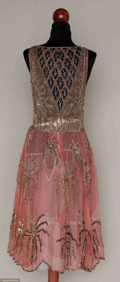 PINK & SILVER BEADED PARTY DRESS, MID 1920sPale pink chiffon w/ darker pink large fan shape inserts, silver glass, sequin & rhinestone multi-petal blossoms, beaded lattice inserts on F & B bodice, full skirt & scalloped hem. Back