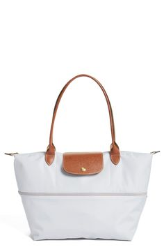 Been looking for a cute, durable tote for traveling, and this pearl white Longchamp bag spotted at the Anniversary Sale could be just the ticket!