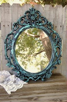 Shabby chic, oval mirror hand painted in aqua over black, with a protective coating. The mirror has a picture wire hanger. Perfect for wedding, shabby chic, nursery or cottage decor. The mirror is ova